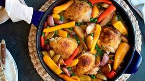 Chicken thighs are browned; then braised with potatoes,