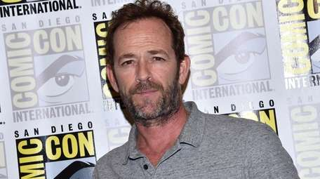 Luke Perry arrives for the press line