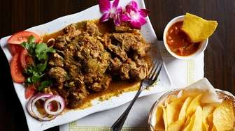 Goat mofongo features a hunk of meat stewed