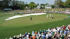 Charl Schwartzel of South Africa putts on the