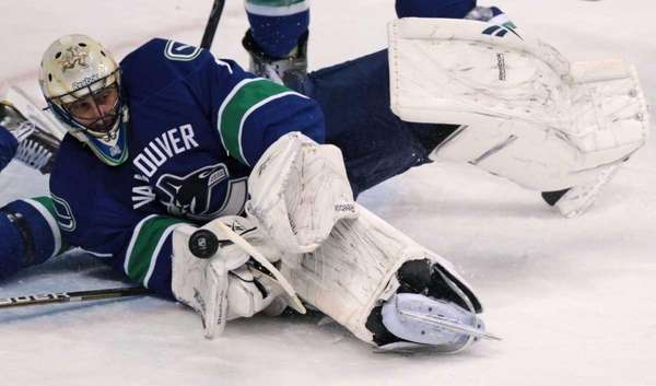 Vancouver Canucks' Roberto Luongo makes a save against