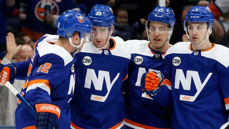 Brock Nelson of the Islanders celebrates his first-period