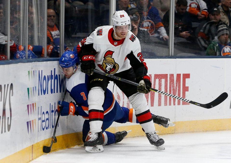 Oscar Lindberg #24 of the Ottawa Senators checks