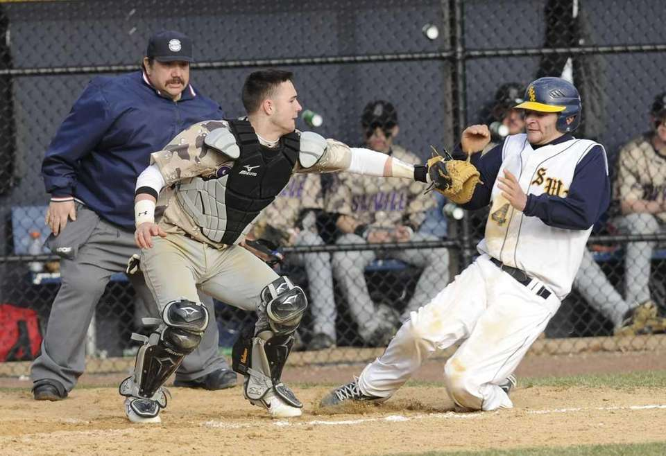 Shoreham-Wading River's Jonathan Criscito is tagged out at