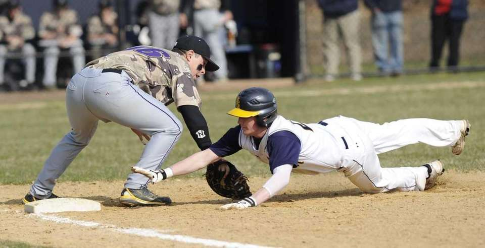 Shoreham-Wading River's Ryan McAlary is safe at first,