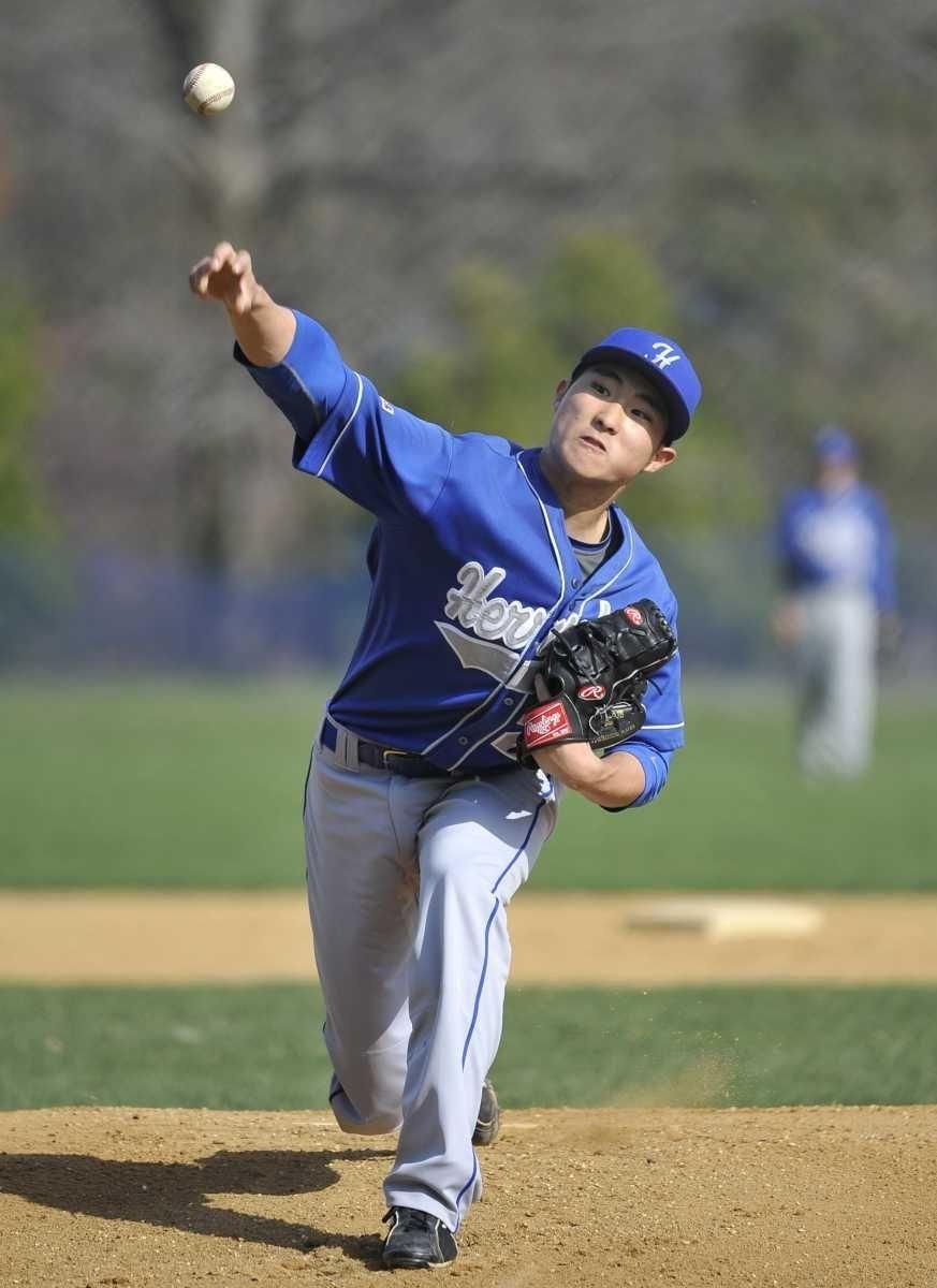 Herricks starting pitcher Jeff Kim throws in the