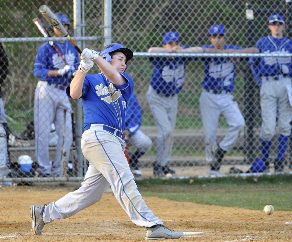 Herricks' Alex Katz hits the ball off his