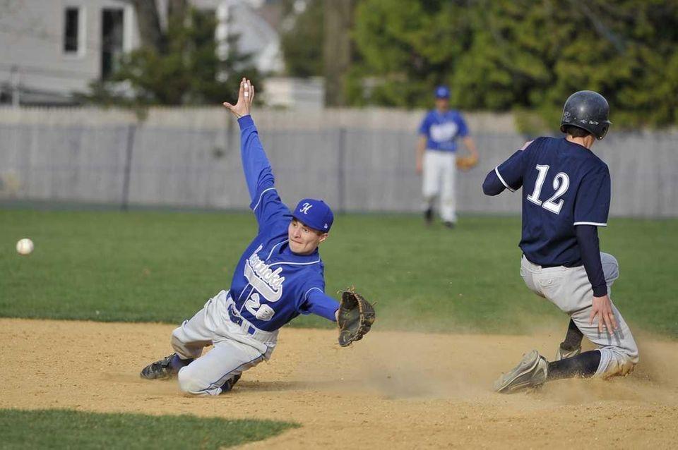 Herricks' James Newman tries to field a throw