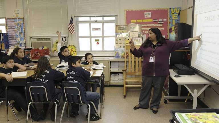 Denise George teaches her fourth grade class at
