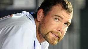 Mets starting pitcher Mike Pelfrey sits in the