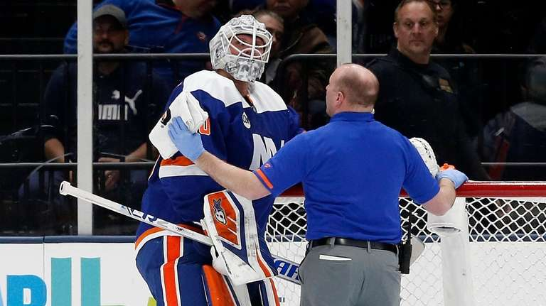 Robin Lehner of the Islanders is checked out