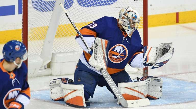 Islanders goaltender Christopher Gibson makes a glove save