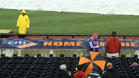 Fans of the New York Mets wait out