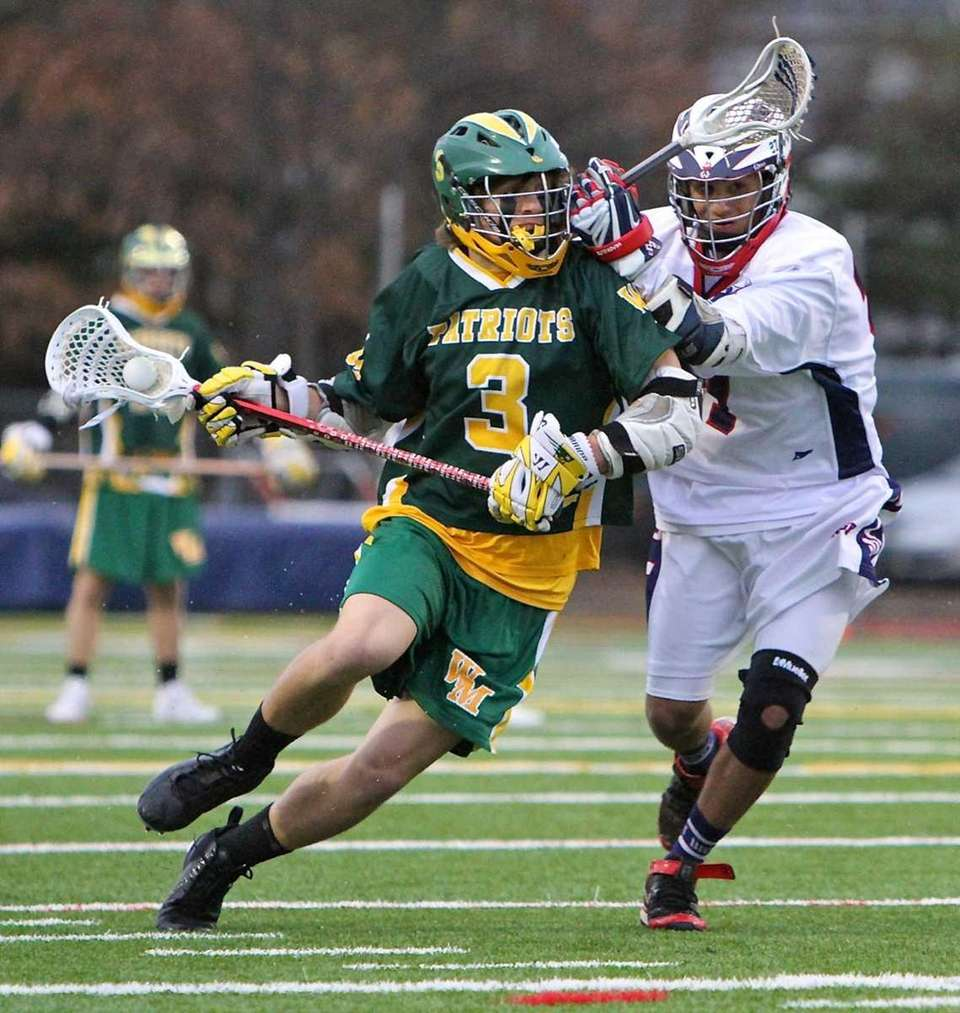 Ward Melville midfield Jimmy Coughlin #3 moves around