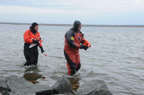 Suffolk County police marine units take measurements for