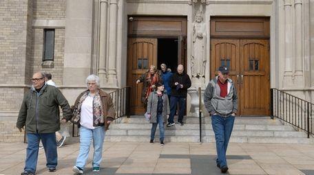 Parishioners leave St. Agnes Cathedral in Rockville Centre