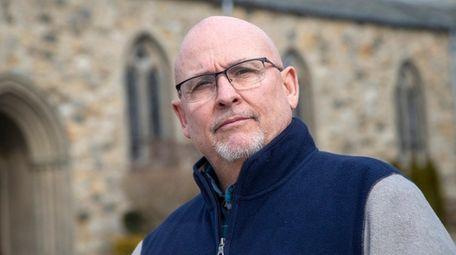 Eric Bauman, a lay eucharistic minister, seen outside