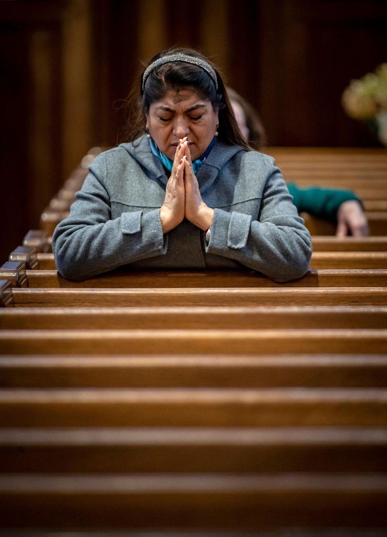 Greta Lozada of Baldwin praying St. Agnes Parish