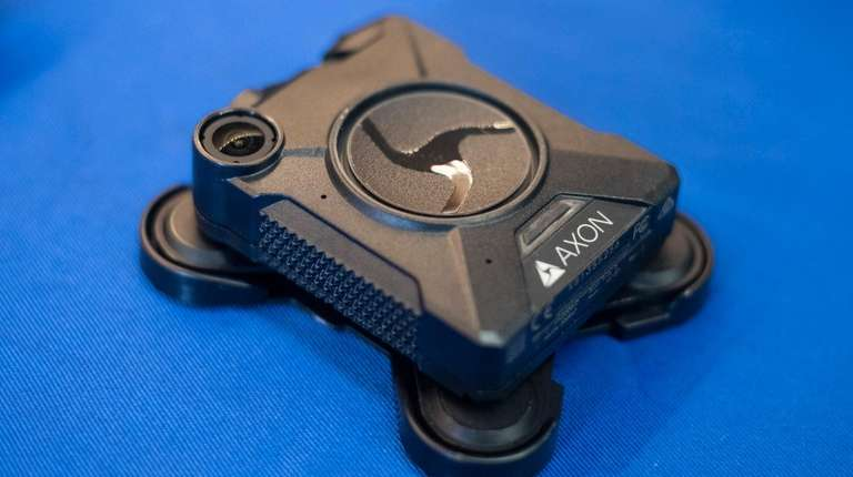 An NYPD Axon-Body2 model body camera is displayed