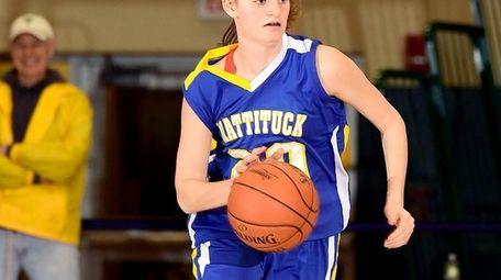 Mackenzie Hoeg #20 of Mattituck handles the ball