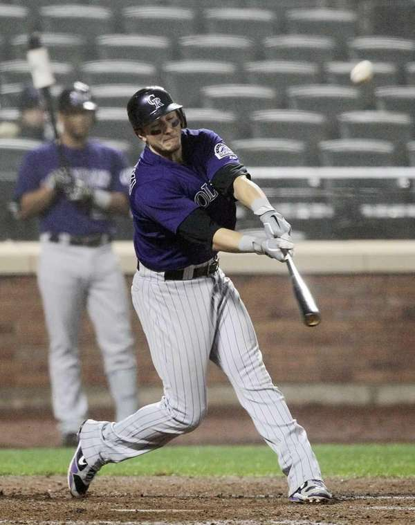Troy Tulowitzki #2 of the Colorado Rockies connects