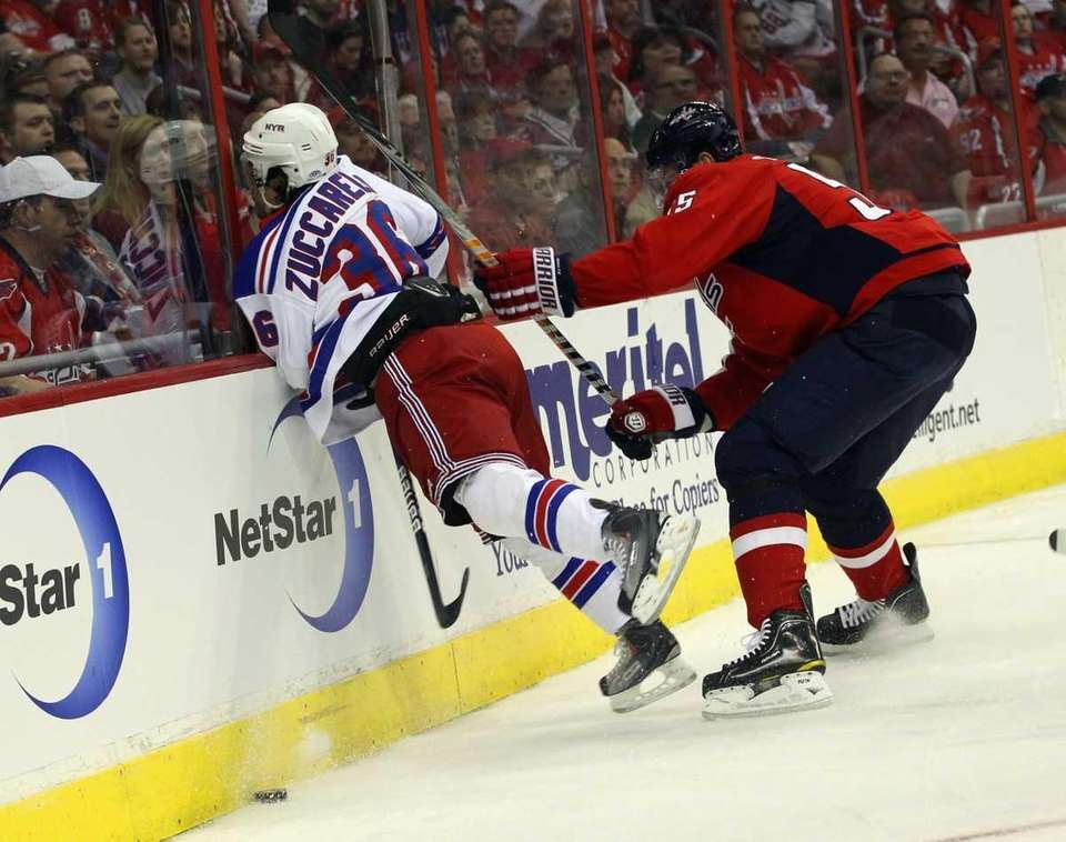 Jeff Schultz #55 of the Washington Capitals hits