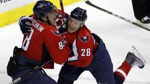 Washington Capitals' Alexander Semin (28) and Alex Ovechkin