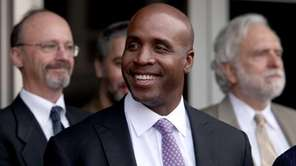 Former San Francisco Giants' Barry Bonds listens to