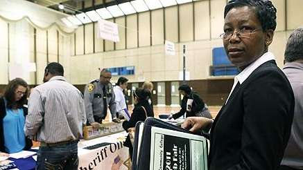 Monica Lecointe walks through the job fair at