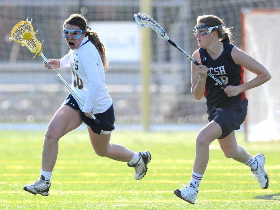 Massapequa High School #10 Danielle Doherty, left, races