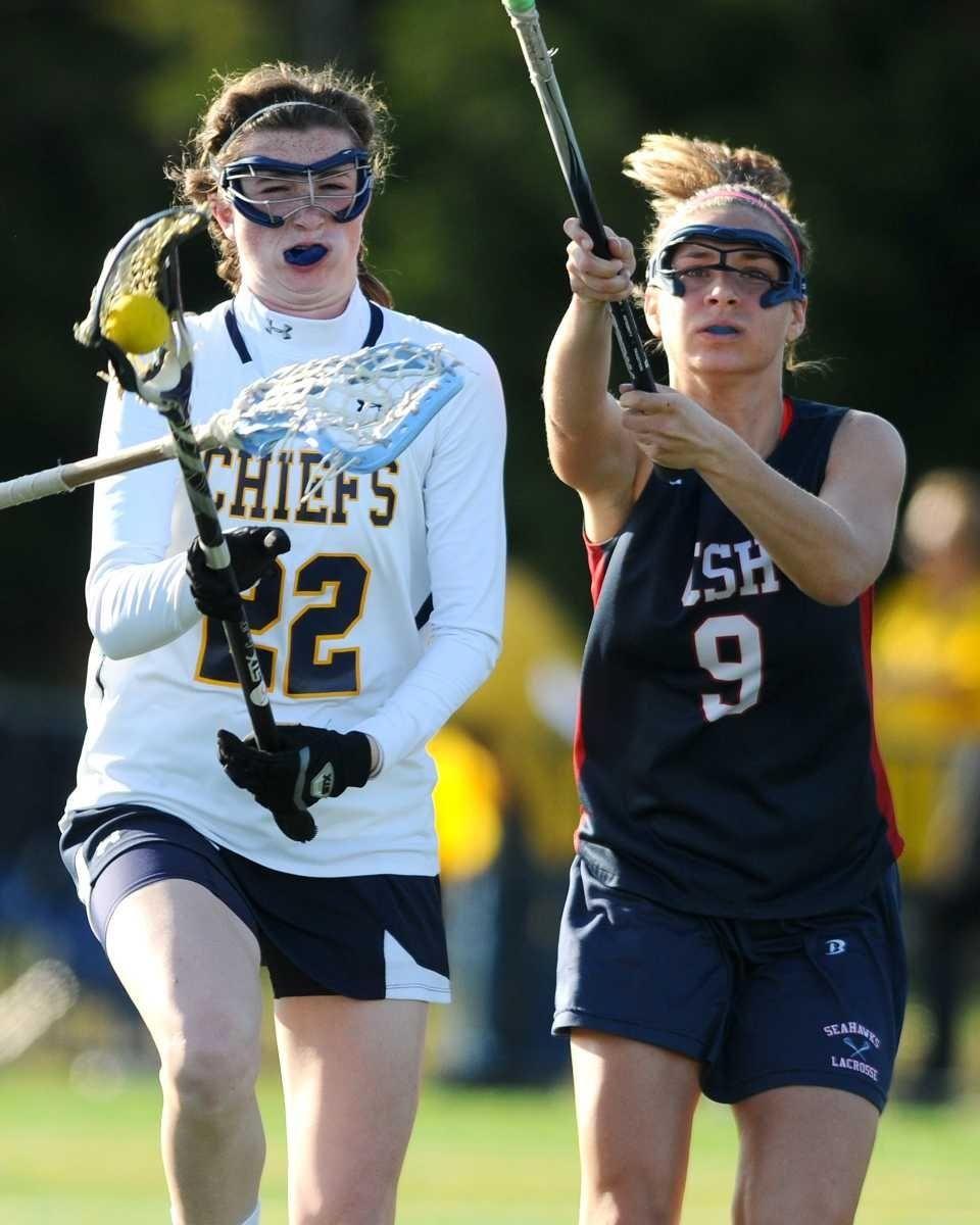 Massapequa High School #22 Kelsey O'Brien, left, gets