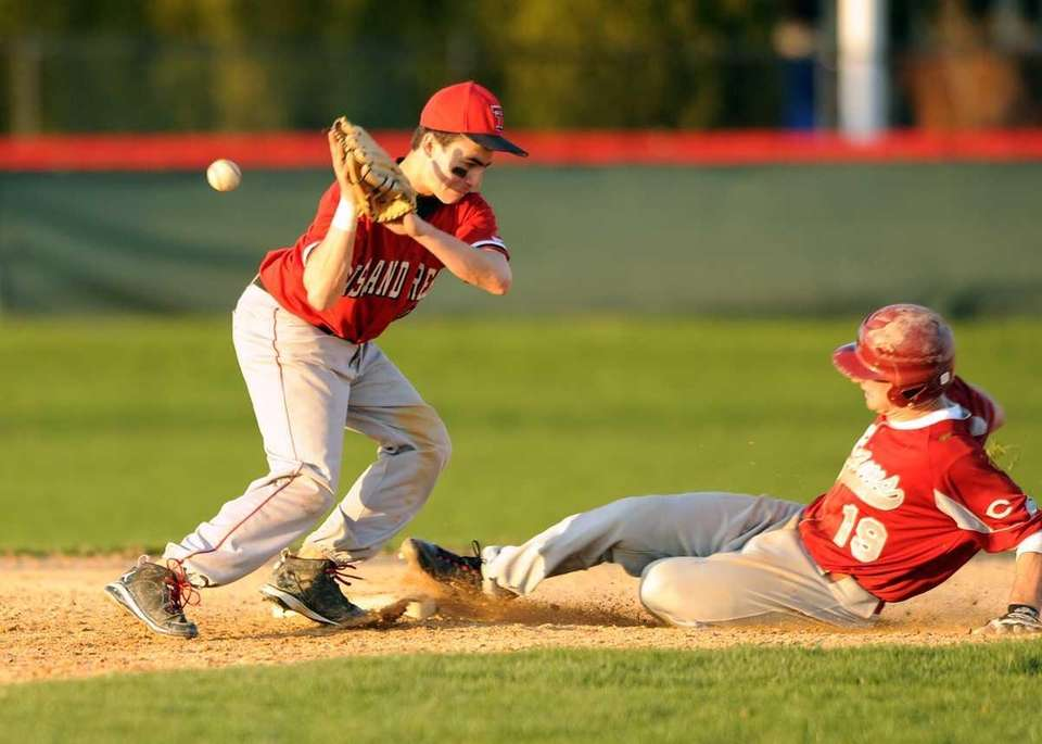Clarke's Michael Alosisio (19) steals second on a