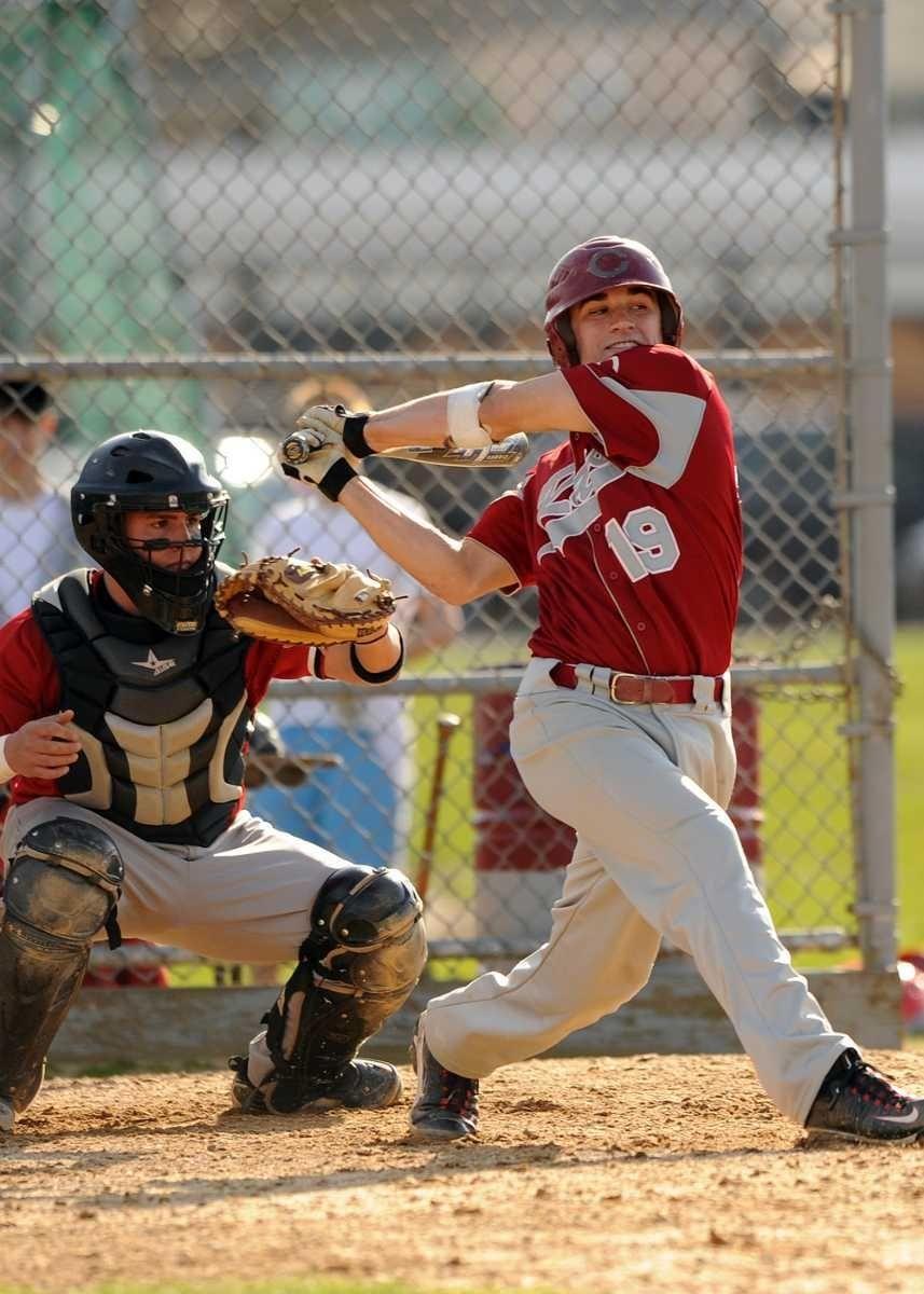 Clarke Michael Aloisio (19) swings through a pitch.