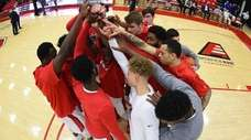 Stony Brook players huddle before a men's basketball