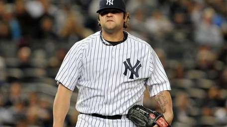 Yankees relief pitcher Joba Chamberlain walks off the