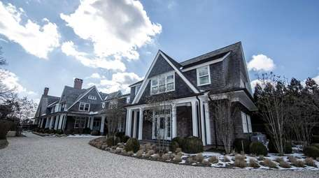 This traditional shingle-style eight-bedroom home on 2.8 acres