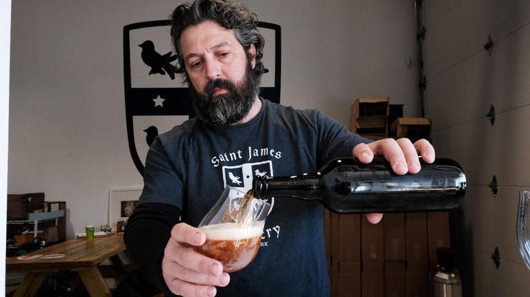 Jamie Adams, co-owner of Saint James Brewery, fills
