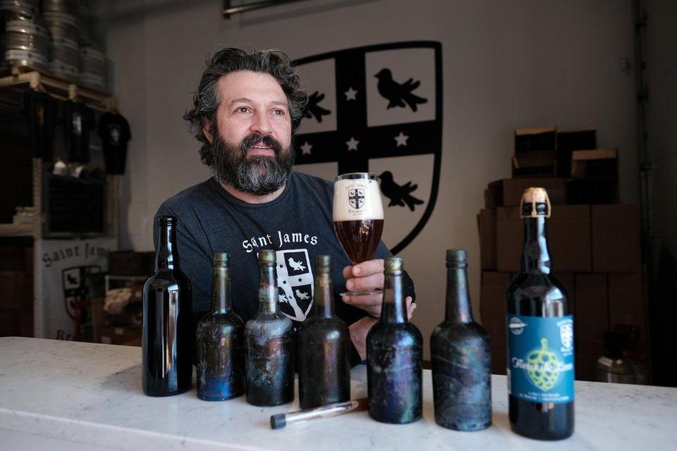 Jamie Adams, co-owner of Saint James Brewery, poses