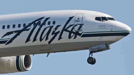 An Alaska Airlines Boeing 737 single-aisle narrow-body jet