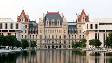 The NY State Capitol Building and reflection in