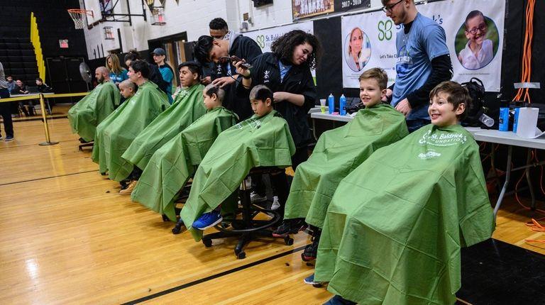 St. Baldrick's participants get their hair shorn March