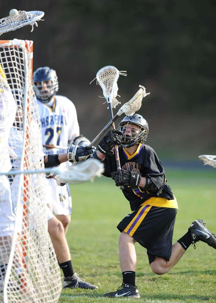 Sayville's Josh Tordik (16) shot on goal is