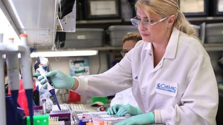A Chembio Diagnostics scientist in Medford analyzes protoypes