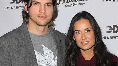Actors Ashton Kutcher and Demi Moore attend the