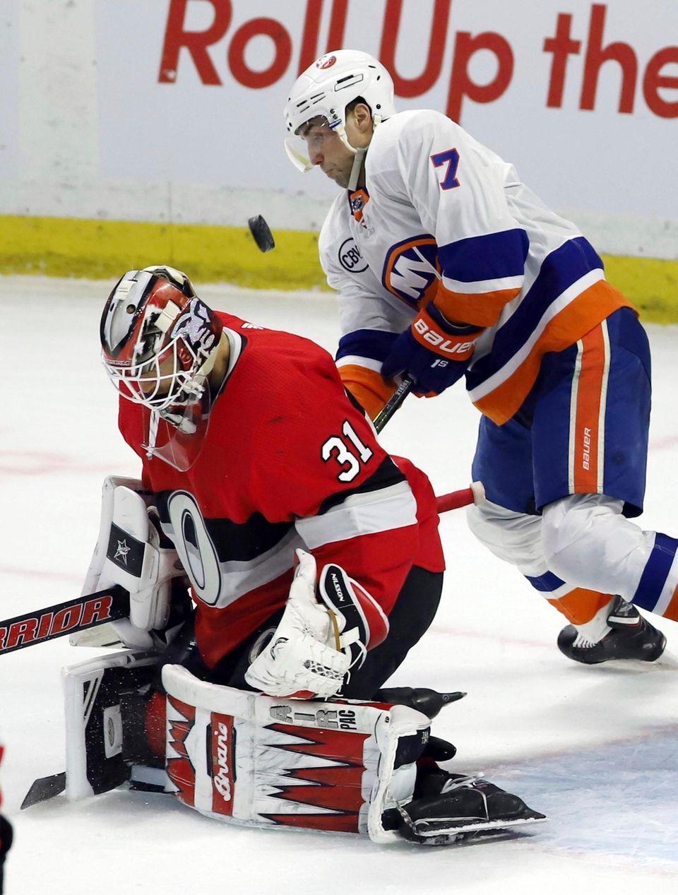 The puck gets behind Ottawa Senators goaltender Anders