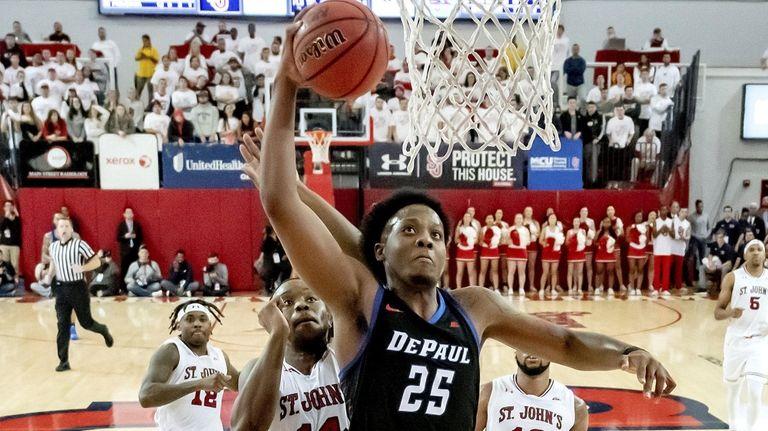 DePaul's Femi Olujobi dunks against St. John's at