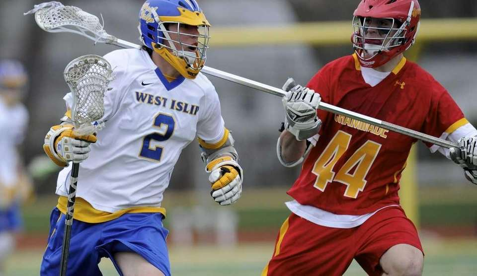 West Islip's Conor Braddish is defended by Chaminade's