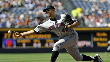 New York Mets starter D.J. Carrasco delivers to