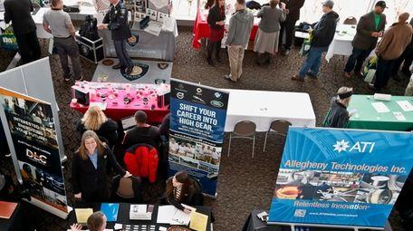 Visitors to the Pittsburgh veterans job fair meet