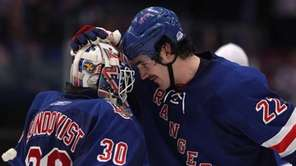 Goalie Henrik Lundqvist #30 and Brian Boyle #22
